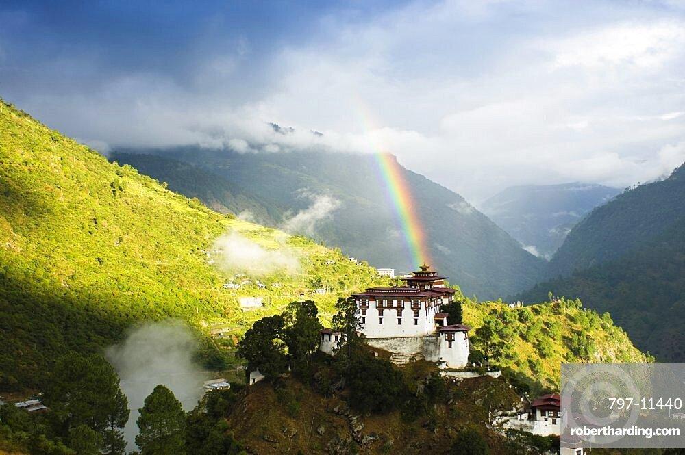 Bhutan, Lhuentse Dzong, Lhuentse Dzong with colourful rainbow overhead.