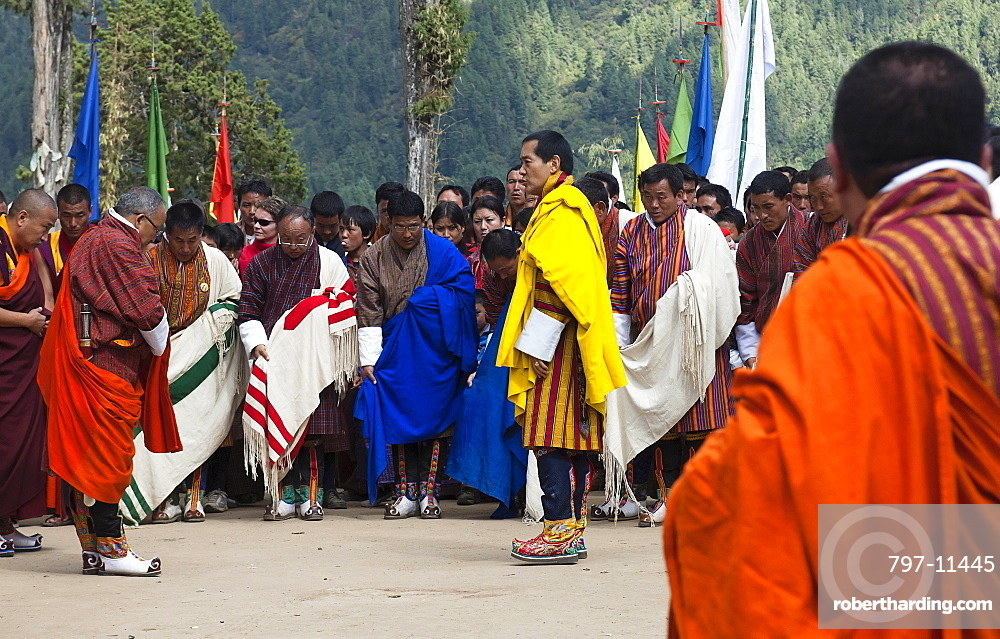 Bhutan, Gangtey Gompa, 4th King of Bhutan leaving after inauguration of new temple; surrounded by ministers, media and police.