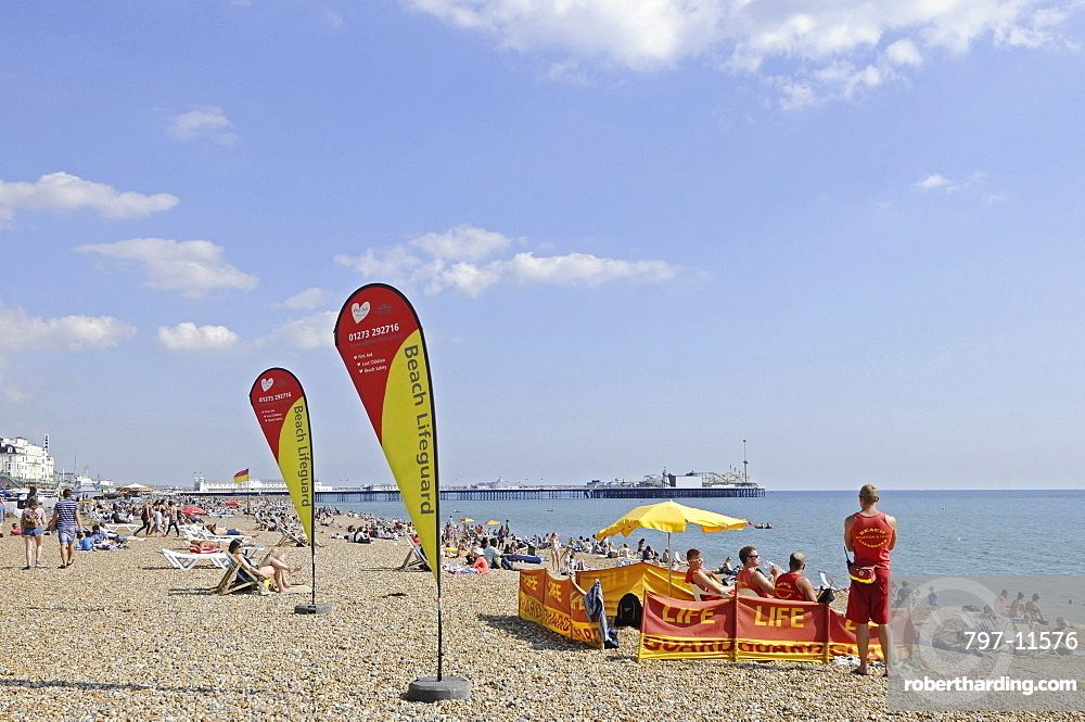 England, East Sussex, Brighton, Lifeguards on the beach.