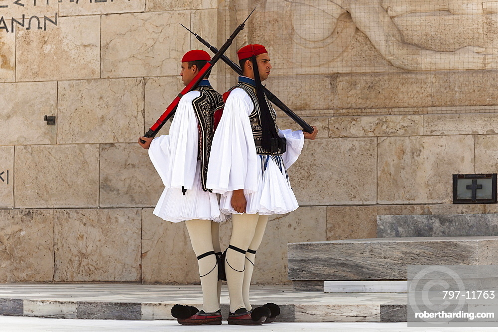 Greece, Attica, Athens, Greek soldiers, Evzones, beside Tomb of the Unknown Soldier, outside Parliament building.