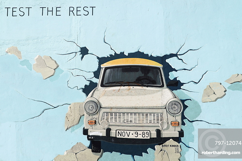 Germany, Berlin, The East Side Gallery, a 1.3 km long section of the Berlin Wall, Birgit Kinder's mural known as 'Test the Best'.