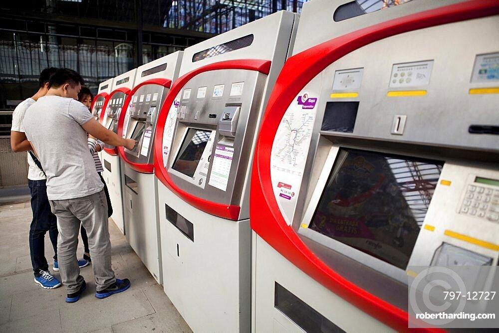 Spain, Madrid, Self-service ticket machines at Principe Pio metro station.