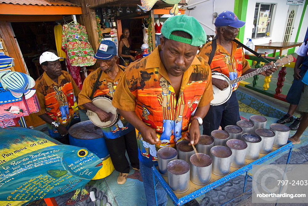 WEST INDIES St Vincent & The Grenadines Union Island Miniature steel drum pan player and band playing at a roadside bar during Easterval Easter Carnival in Clifton