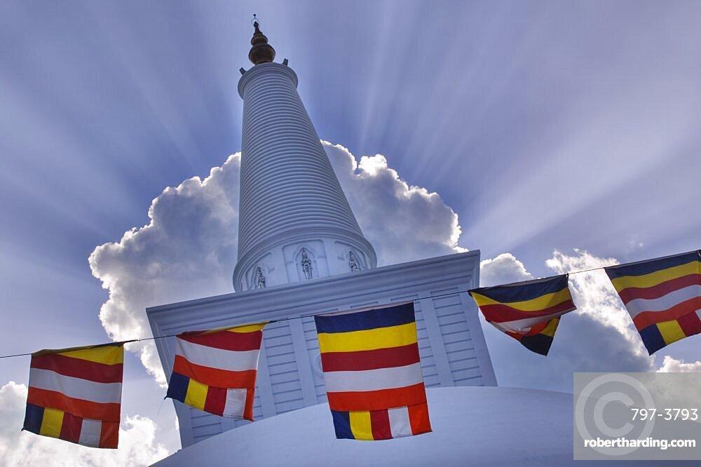 SRI LANKA  Anuradhapura Prayer flags hanging in front of Ruvanvelisaya Dagoba.  worship prayer Buddhism Buddha Asia Sri Lanka travel shrine faith Asian Llankai Sri Lankan