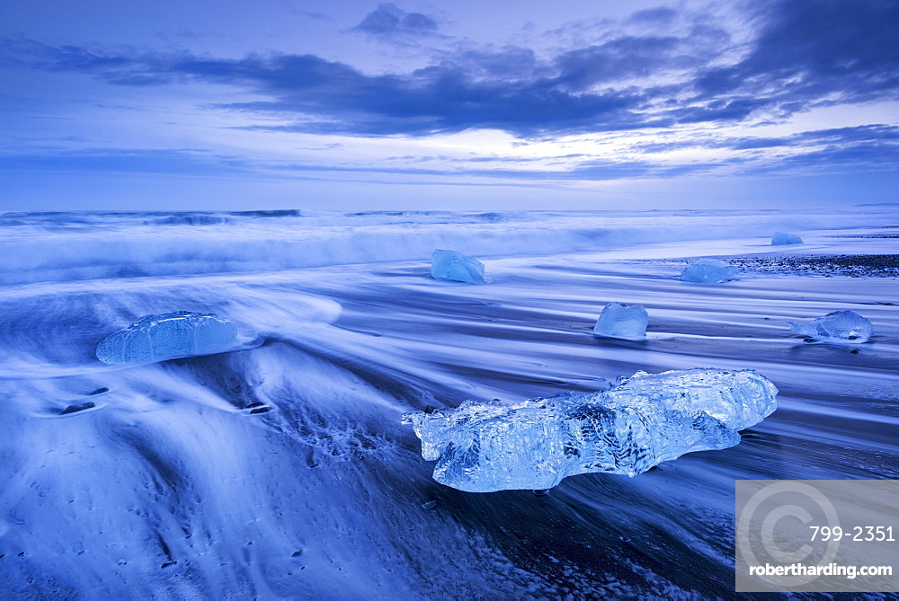 Ice and waves on Jokulsarlon Beach in winter, South Iceland, Polar Regions