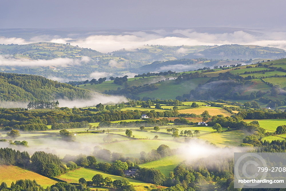 Mist covered rolling countryside at dawn, Brecon Beacons, Wales, United Kingdom, Europe