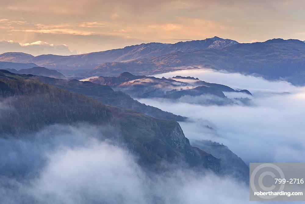 Mist shrouded mountains at dawn, Lake District, Cumbria, England, United Kingdom, Europe