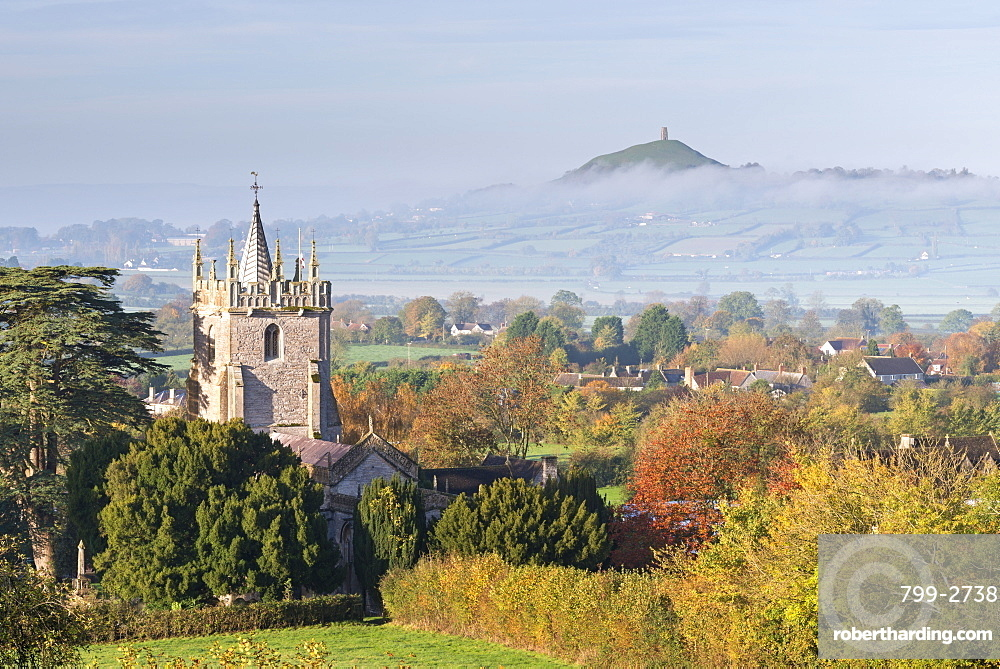 Glastonbury Tor and West Pennard Church on a misty autumn morning, Somerset, England, United Kingdom, Europe