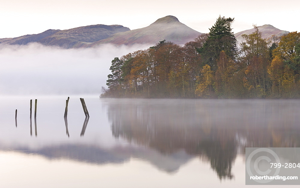Early morning autumn mist over Derwent Water, Lake District National Park, Cumbria, England, United Kingdom, Europe