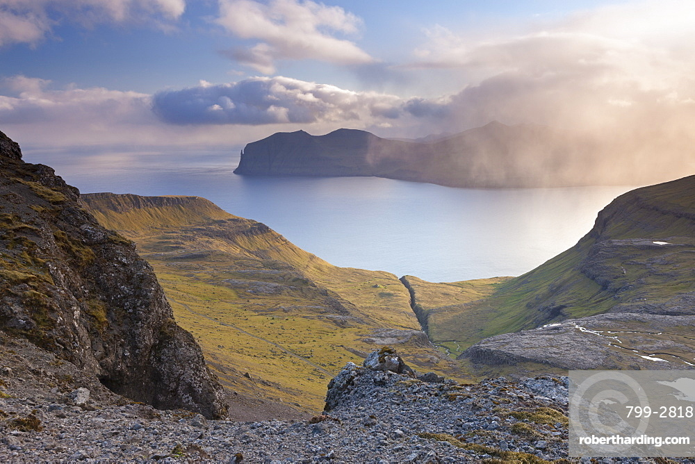Looking towards the island of Vagar from the mountains of Streymoy in the Faroe Islands, Denmark, Europe