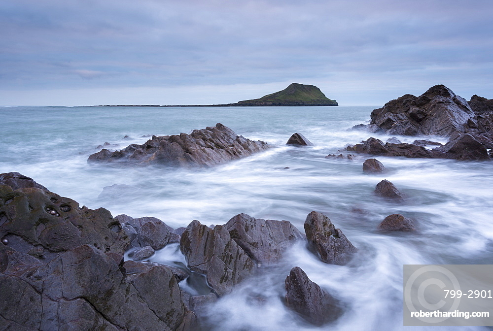 Rocky coast of the Gower looking towards Worm's Head in winter, South Wales, Wales, United Kingdom, Europe