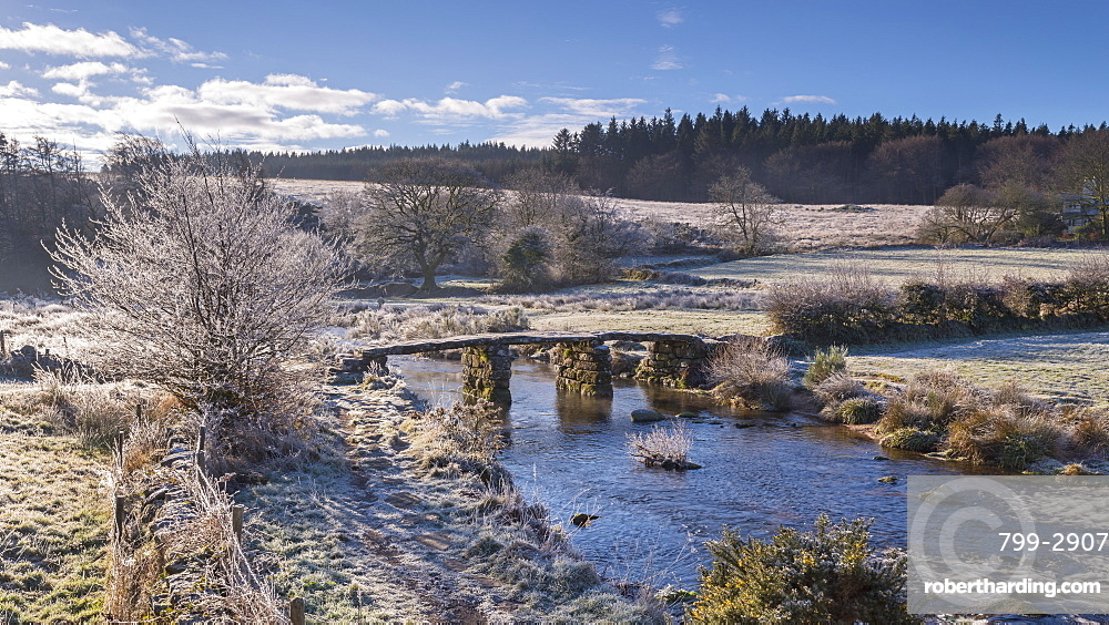 Frosty winter conditions at the old clapper bridge at Postbridge, Dartmoor, Devon, England, United Kingdom, Europe