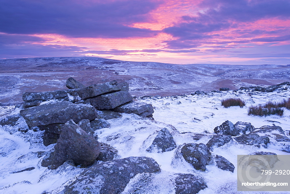 Beautiful winter sunrise over a frozen and snow covered Belstone Tor, Dartmoor National Park, Devon, England, United Kingdom, Europe