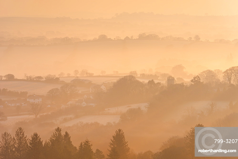 Misty and frosty winter sunrise over Dartmoor countryside near Throwleigh, Devon, England, United Kingdom, Europe