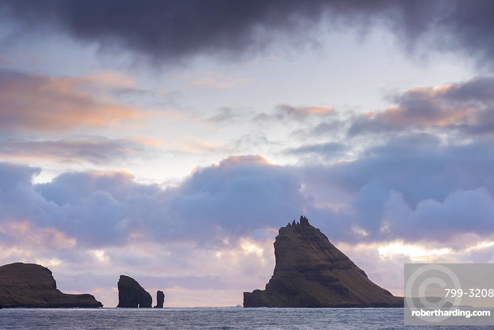Dramatic outline of Tindholmur island at sunset, Vagar, Faroe Islands, Denmark, Europe