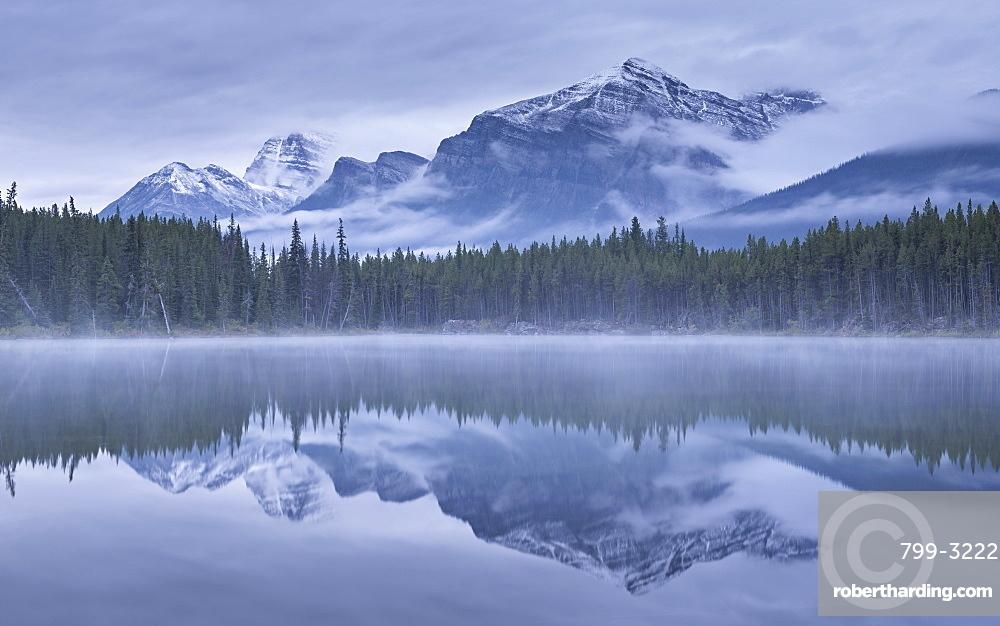 Dramatic Canadian Rockies mountain vista reflected in Herbert Lake, Banff National Park, UNESCO World Heritage Site, Alberta, Canada, North America