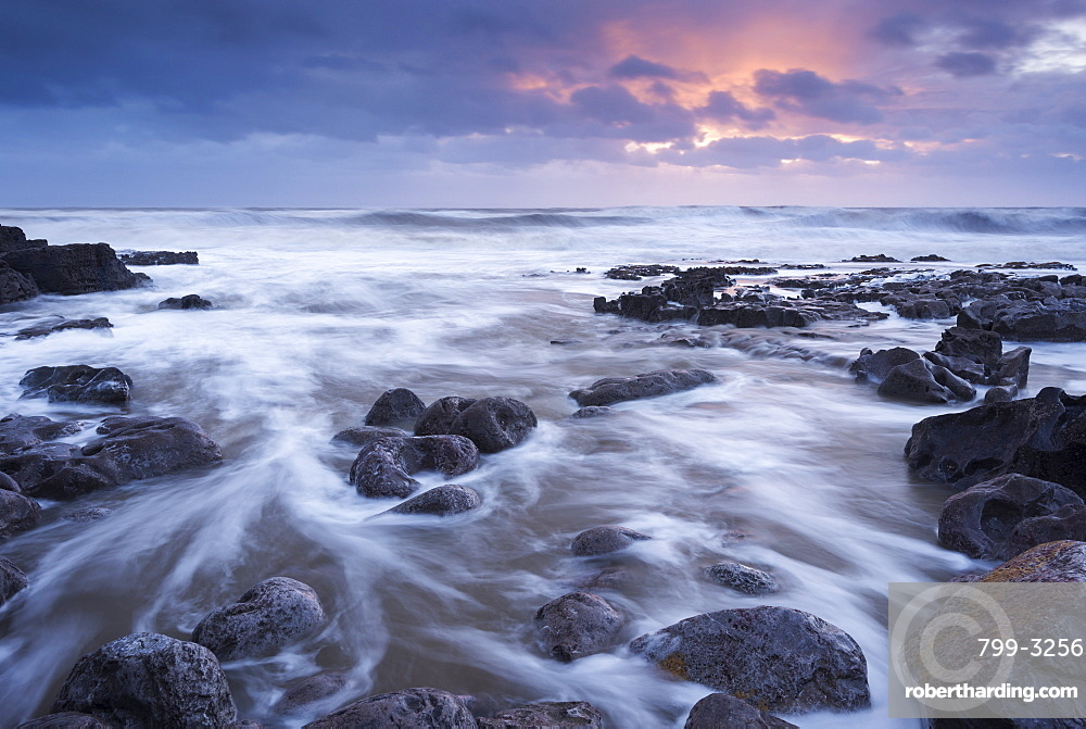 Sunset over the rocky shores of Porthcawl in South Wales, Wales, United Kingdom, Europe