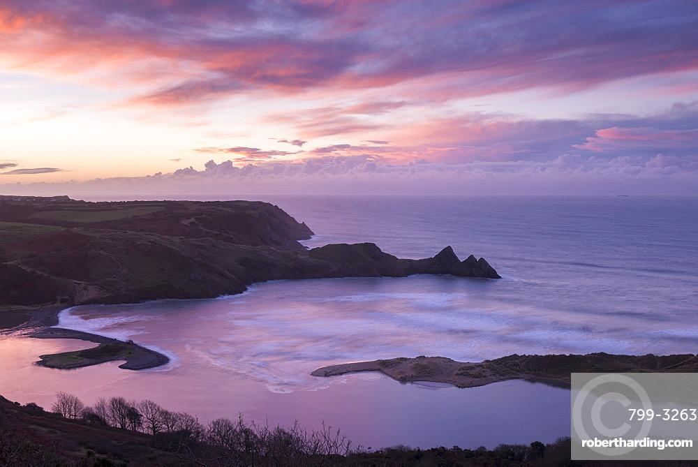 Beautiful dawn sky over Three Cliffs Bay in winter, Gower Peninsula, Wales, United Kingdom, Europe
