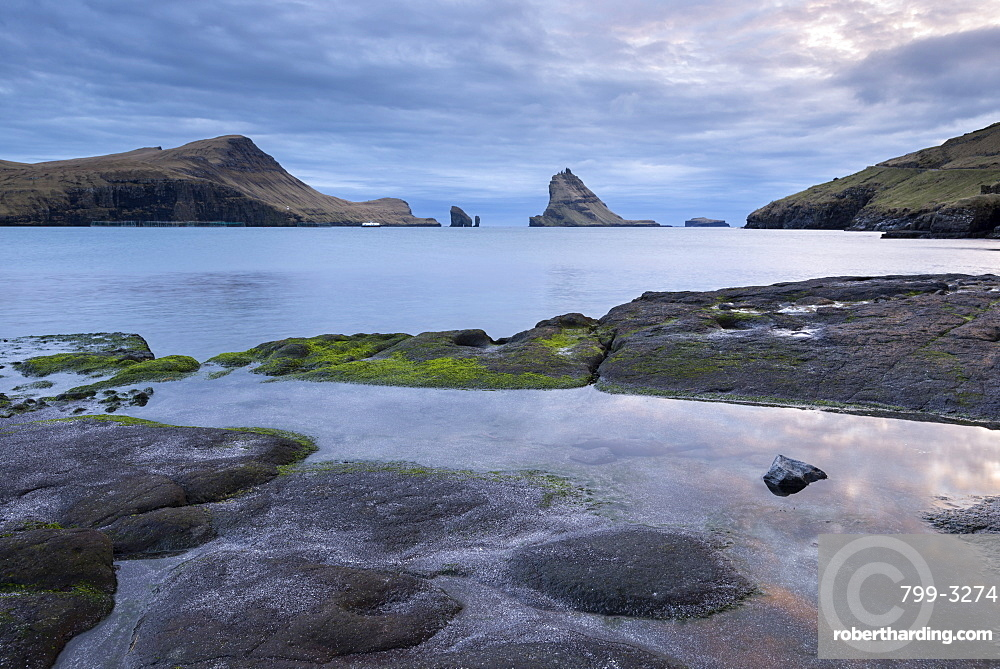 View towards Tindholmur from the rocky shores of Bour, Vagar, Faroe Islands, Denmark, Europe