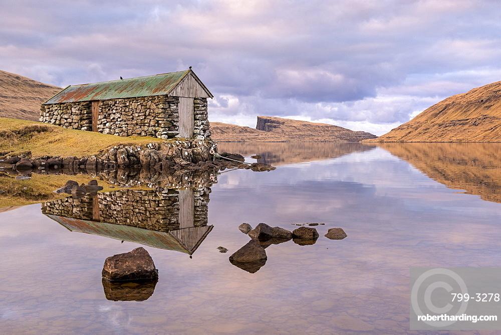 Stone boathouse on Sorvagsvatn (Leitisvatn Lake) on the island of Vagar in the Faroe Islands, Denmark, Europe