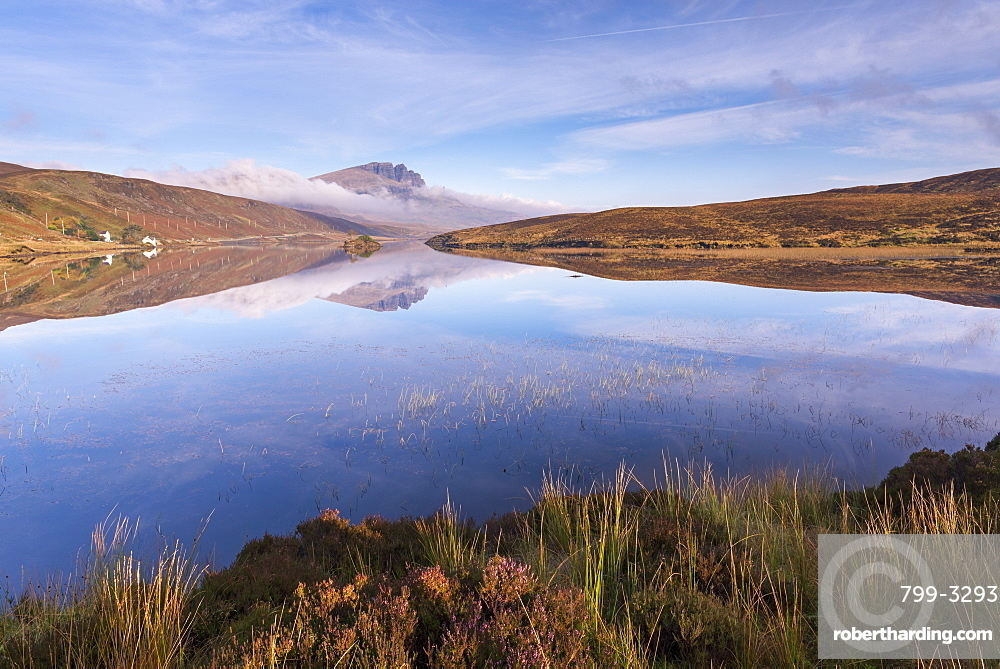 Perfect reflections at Loch Fada on the Isle of Skye, Inner Hebrides, Scotland, United Kingdom, Europe