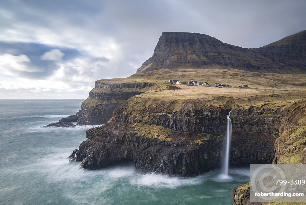 Dramatic coastal scenery near the village of Gasadalur on the island of Vagar in the Faroe Islands, Denmark, Europe
