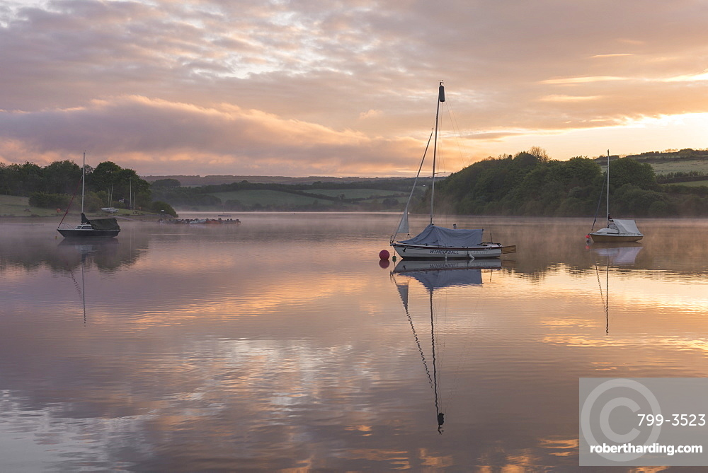 Boats on Wimbleball Reservoir on a beautiful misty morning at sunrise, Exmoor National Park, Somerset, England, United Kingdom, Europe