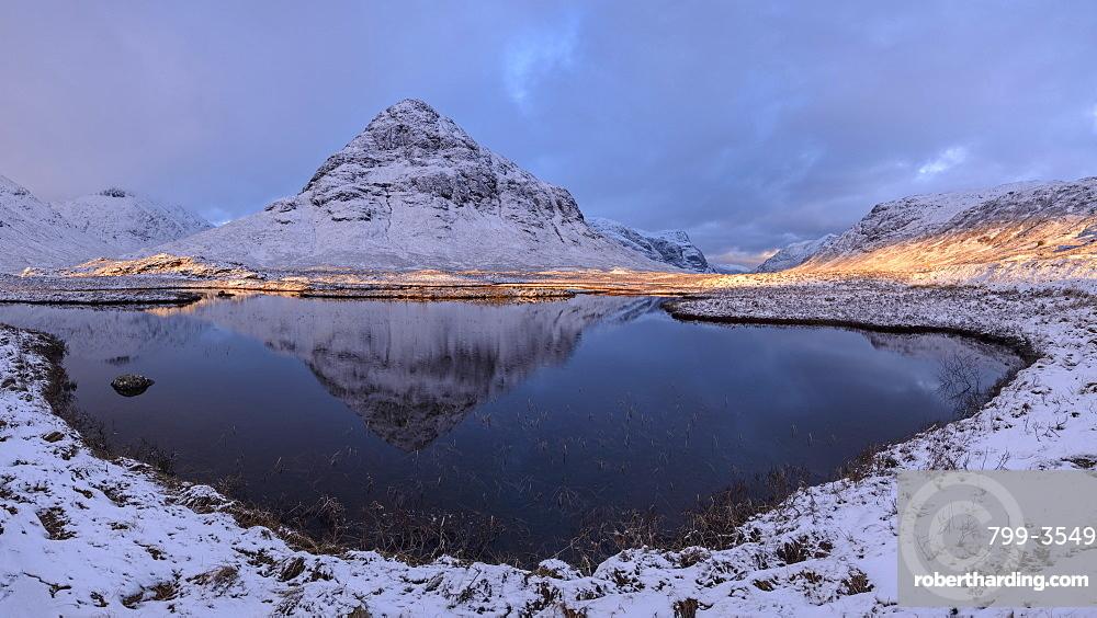 Buachaille Etive Beag mountain reflected in Lochan na Fola, Glencoe, Argyll, Scotland, United Kingdom, Europe