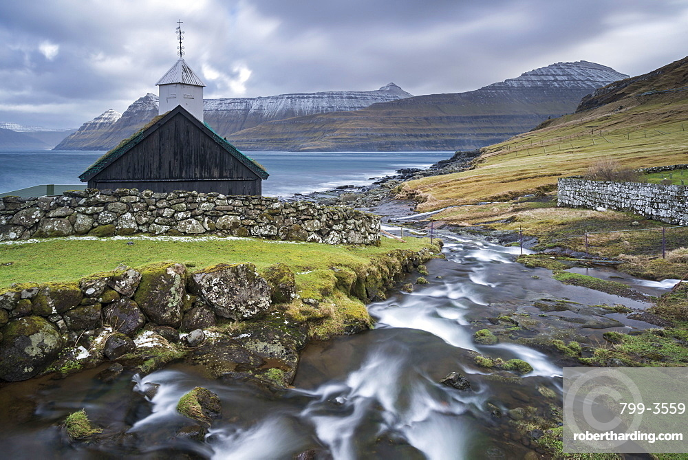 Traditional Faroese wooden turf roofed church in the village of Funningur, Eysturoy, Faroe Islands, Denmark, Europe