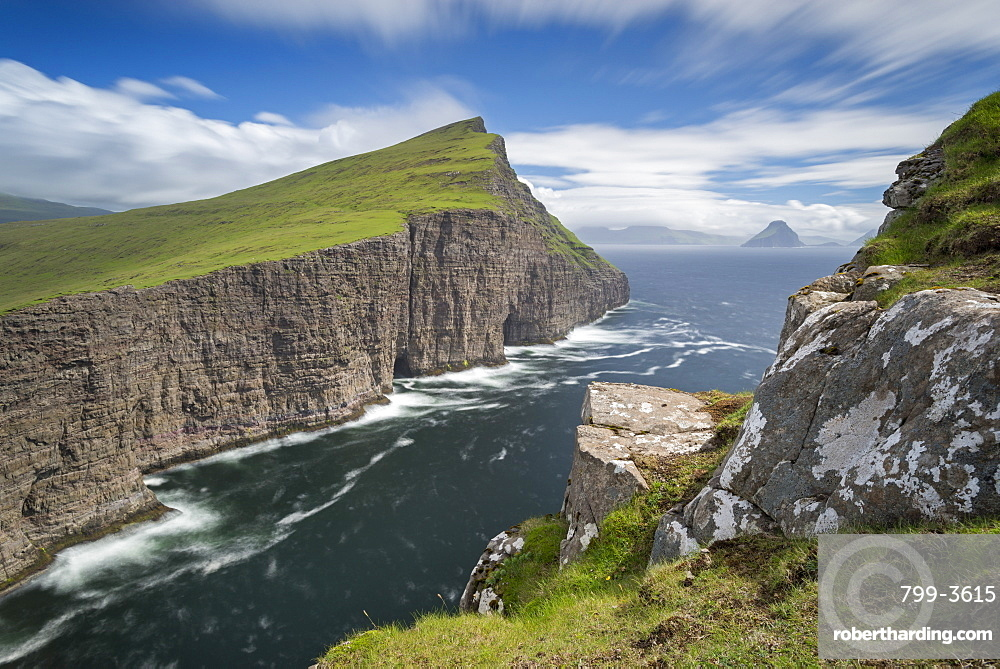 Towering sea cliffs on the island of Vagar in the Faroe Islands, Denmark, Europe