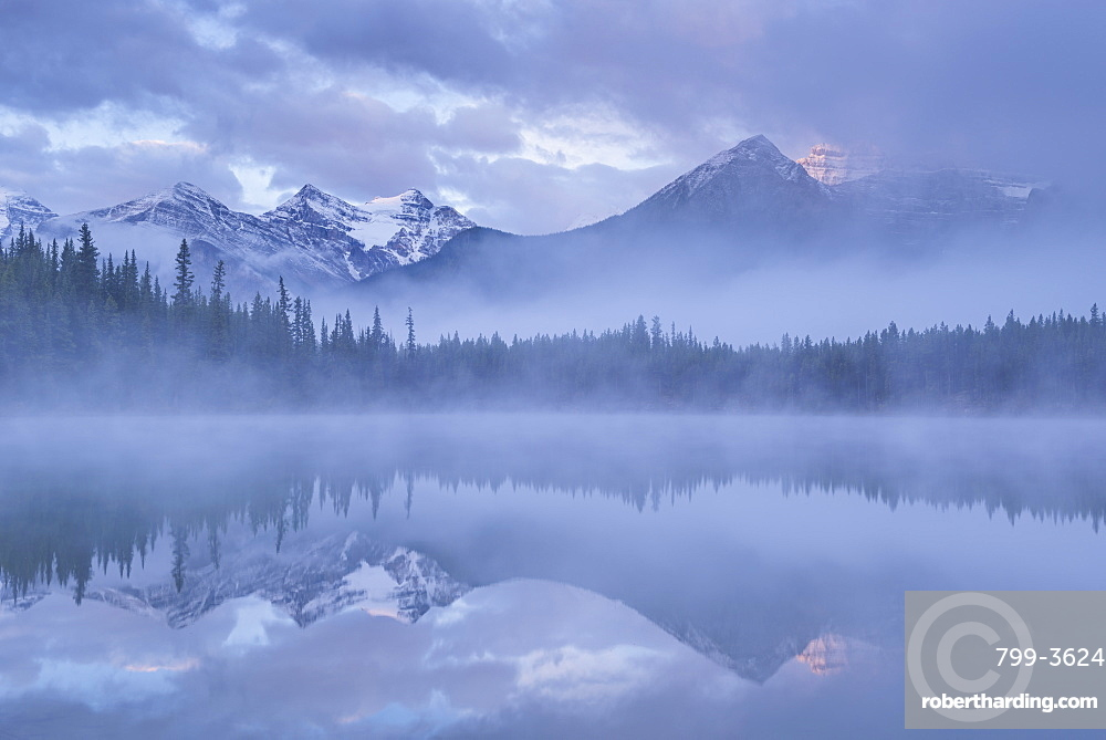 Canadian Rockies and mist reflected in Herbert Lake at sunrise, Banff National Park, UNESCO World Heritage  Site, Alberta, Canada, North America