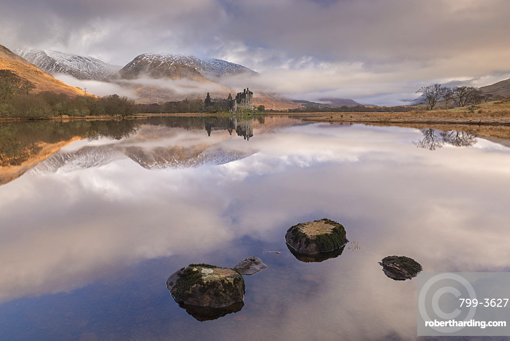 Kilchurn Castle on a reflective Loch Awe in winter, Argyll and Bute, Highlands, Scotland, United Kingdom, Europe