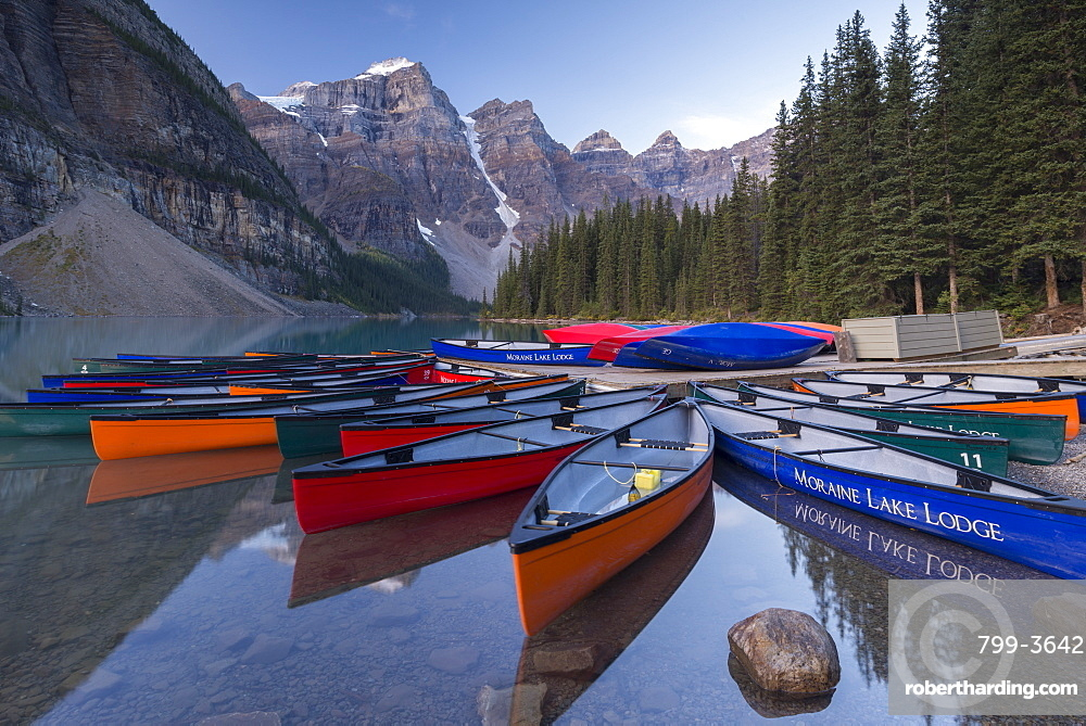 Colouful Canadian Canoes On Moraine Stock Photo