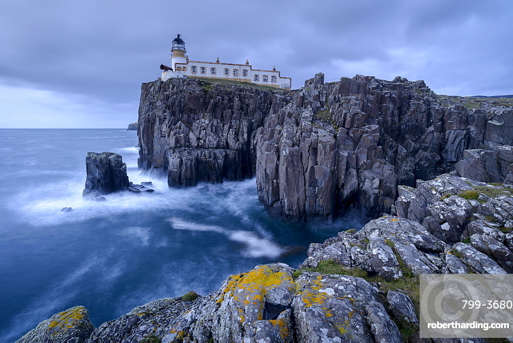 Neist Point lighthouse, perched on dramatic cliff tops on the west coast of the Isle of Skye, Inner Hebrides, Scotland, United Kingdom, Europe