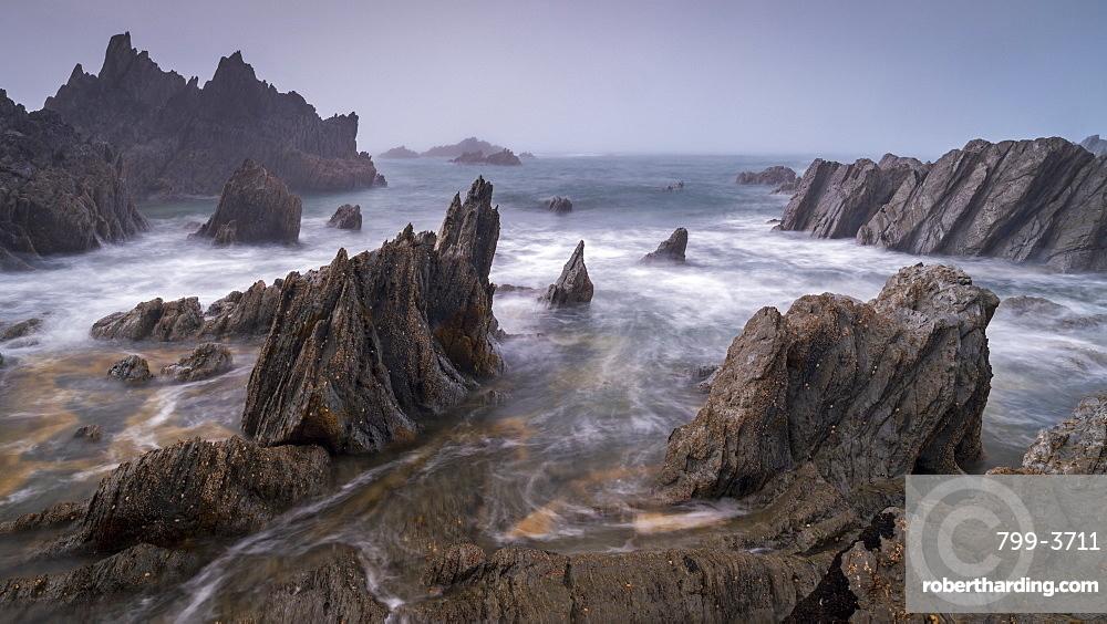 Jagged ledges on the dramatic north Devon coast, Devon, England, United Kingdom, Europe