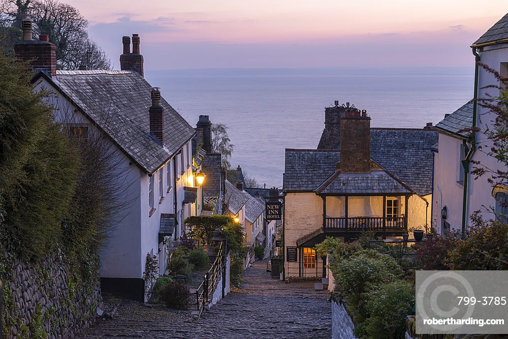 Pink dawn sky above the pretty village of Clovelly on the North Devon coast, Clovelly, England, United Kingdom, Europe