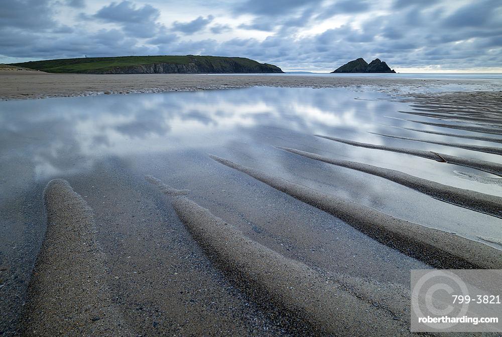 Tidal pools on the sandy beach at Holywell Bay, Cornwall, England, United Kingdom, Europe