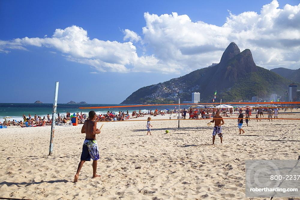 People playing tennis on Ipanema beach at dawn, Rio de Janeiro, Brazil, South America