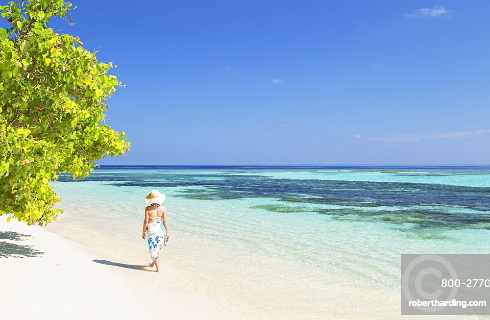 Woman on beach, Rasdhoo Island, Northern Ari Atoll, Maldives, Indian Ocean, Asia