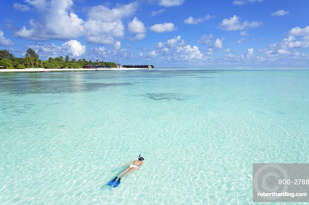 Woman snorkelling at Olhuveli Beach and Spa Resort, South Male Atoll, Kaafu Atoll, Maldives, Indian Ocean, Asia