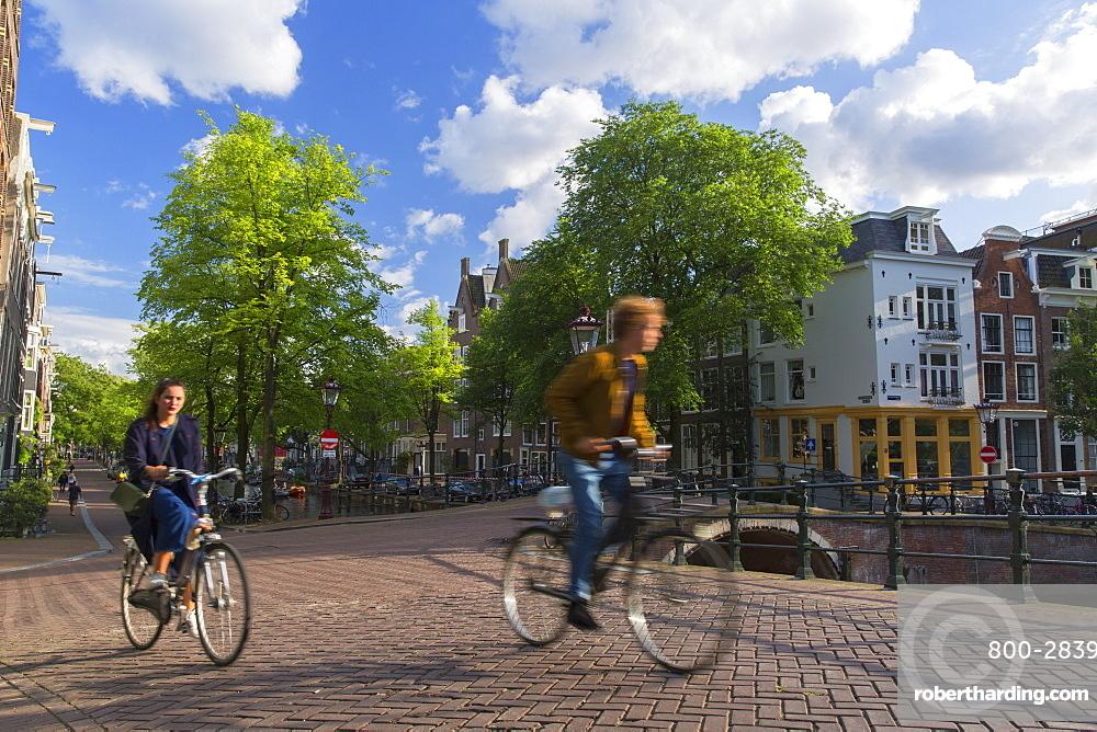 Cyclists on bridge, Amsterdam, Netherlands, Europe