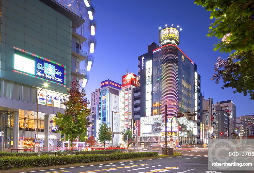 Ferris wheel and shopping street at dusk, Nagoya, Japan