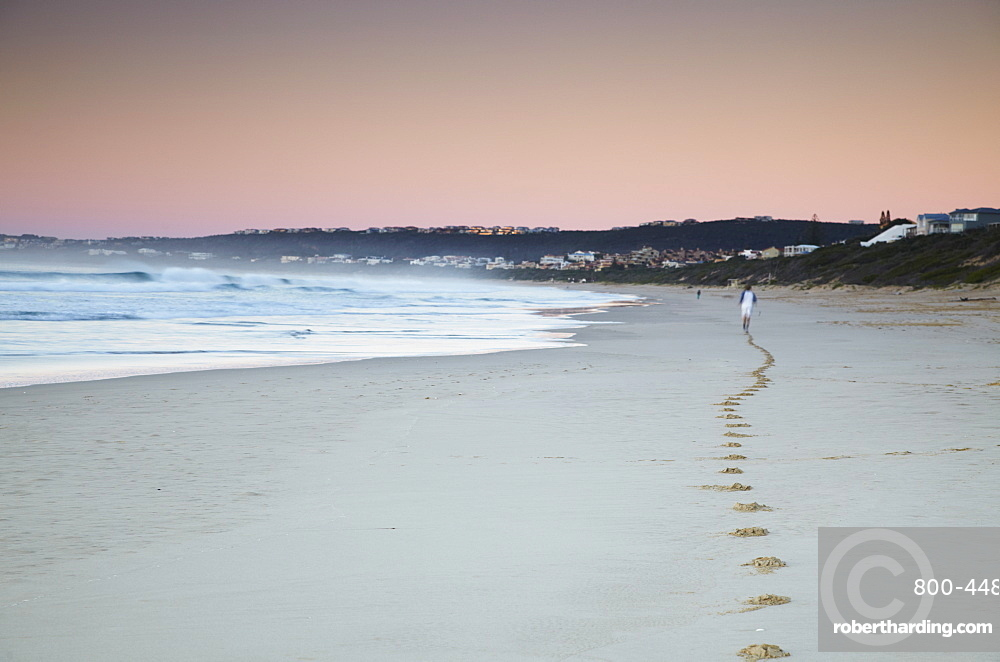 Man jogging on beach at dawn, Plettenberg Bay, Western Cape, South Africa, Africa