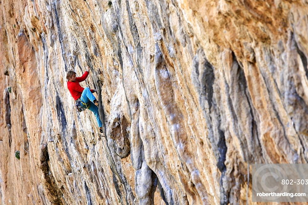 A climber scales cliffs at Chulilla, Valencia, Spain, Europe