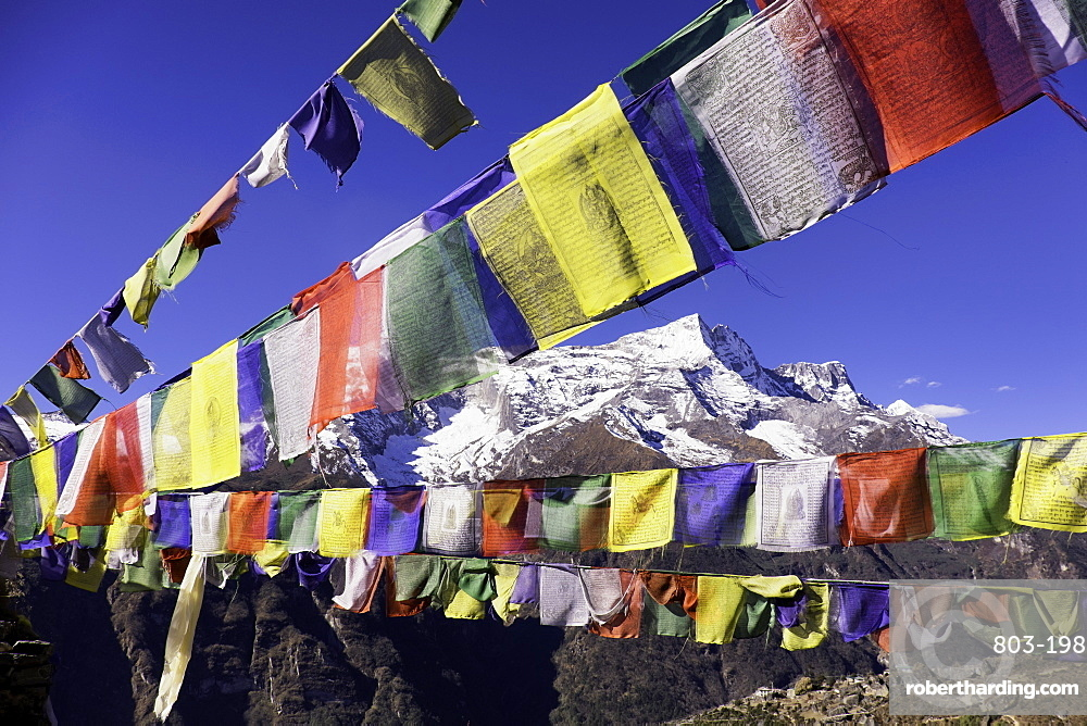 Buddhist prayer flags with Mount Kongde Ri behind taken just above the town of Namche Bazaar, Himalayas, Nepal, Asia
