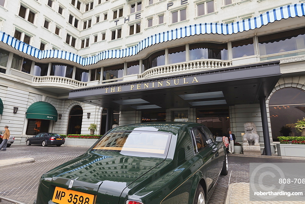 The Peninsula Hotel and one of the hotel's fleet of green Rolls Royces, Hong Kong, China, Asia