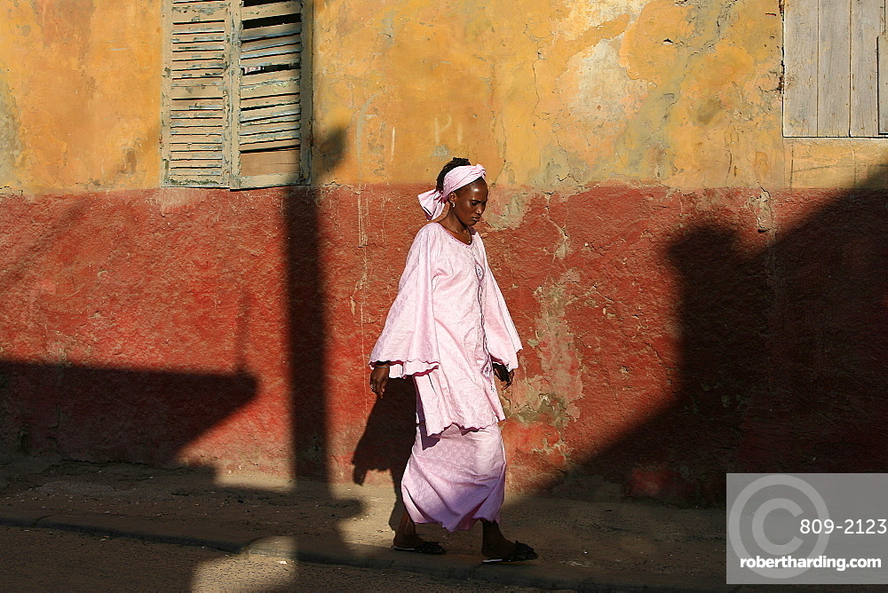 Woman walking in street, St. Louis, Senegal, West Africa, Africa