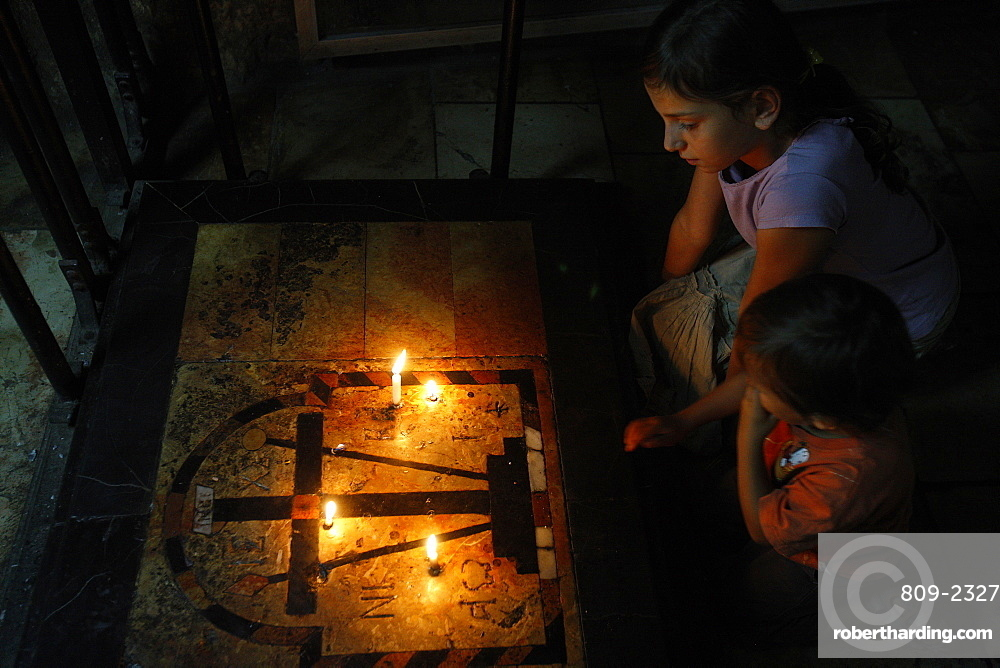 Children in the Holy Sepulchre church, Jerusalem, Israel, Middle East