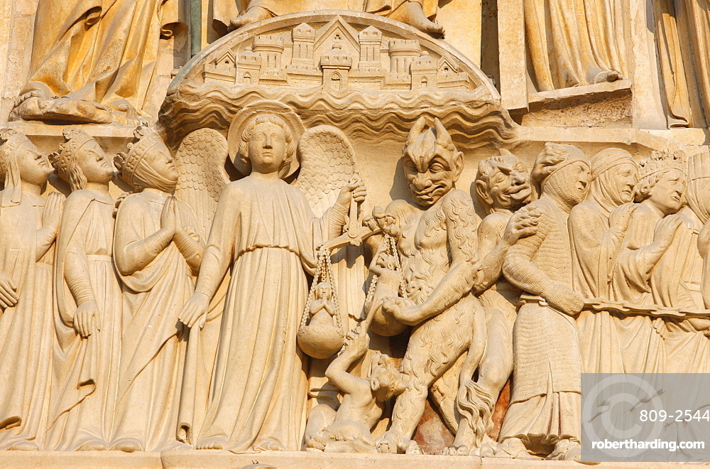 Last Judgment gate tympanum showing the angel St. Michael weighing souls, west front, Notre Dame Cathedral, UNESCO World Heritage Site, Paris, France, Europe