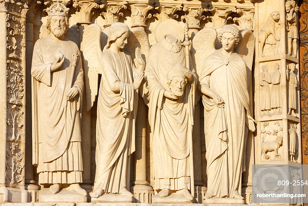 Statues including the Emperor Constantine and St. Denis carrying his head, Virgin's Gate, west front, Notre Dame Cathedral, UNESCO World Heritage Site, Paris, France, Europe